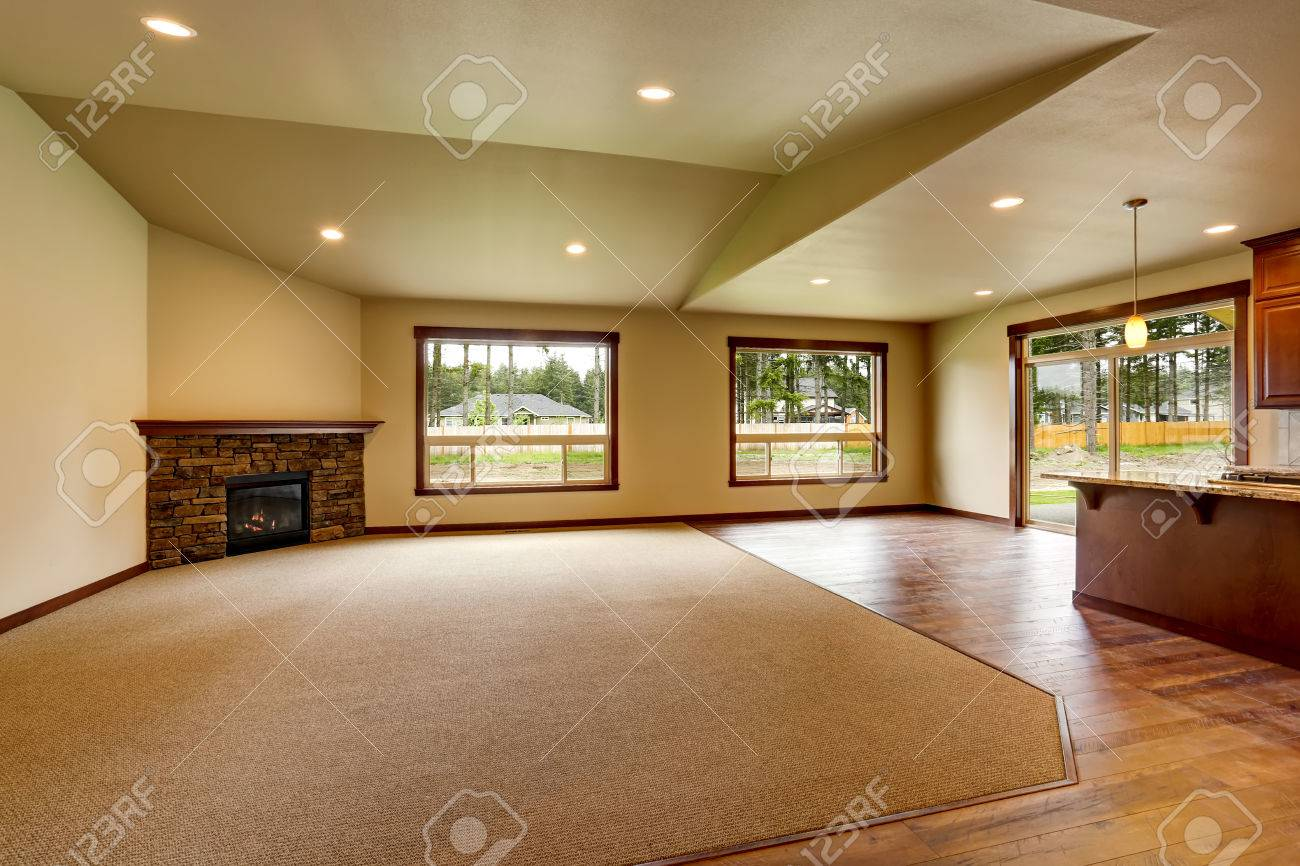 Open Floor Plan. Empty Living Room With Fireplace, And Carpet Floor.  Connected To