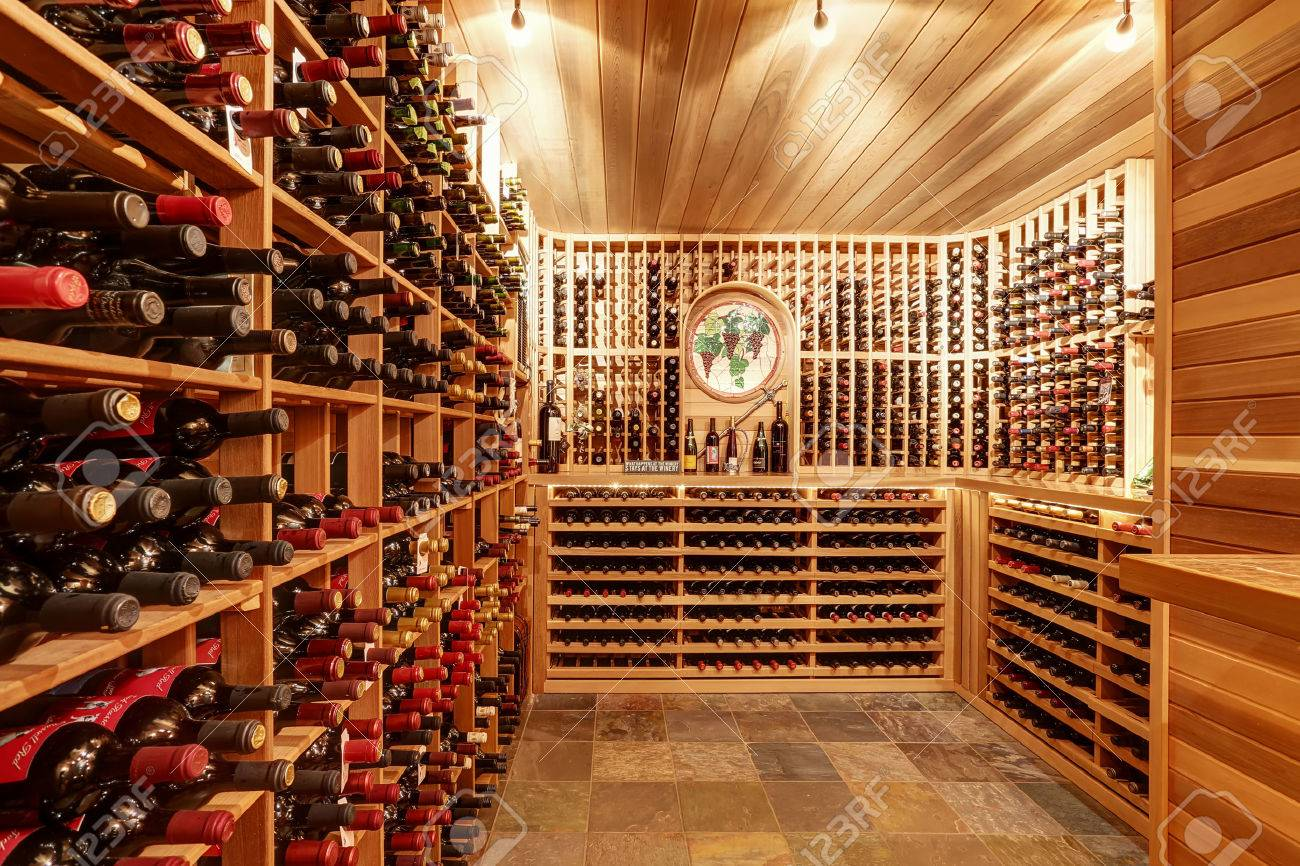 Bright home wine cellar with wooden storage units and arch with bottles. Northwest USA & Bright Home Wine Cellar With Wooden Storage Units And Arch With ...