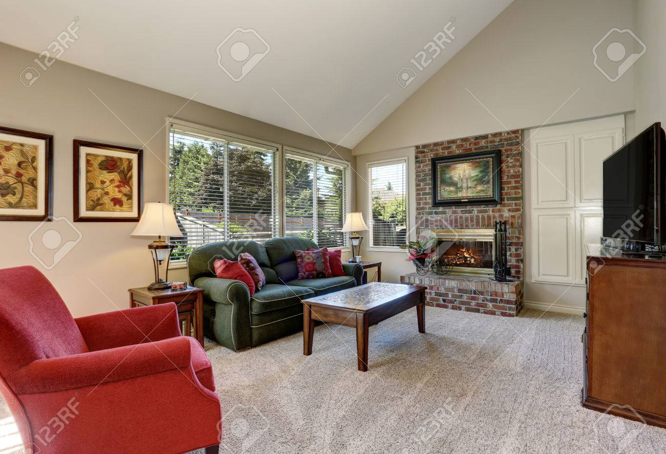 Traditional Living Room Interior With Green Sofa And Brick Fireplace