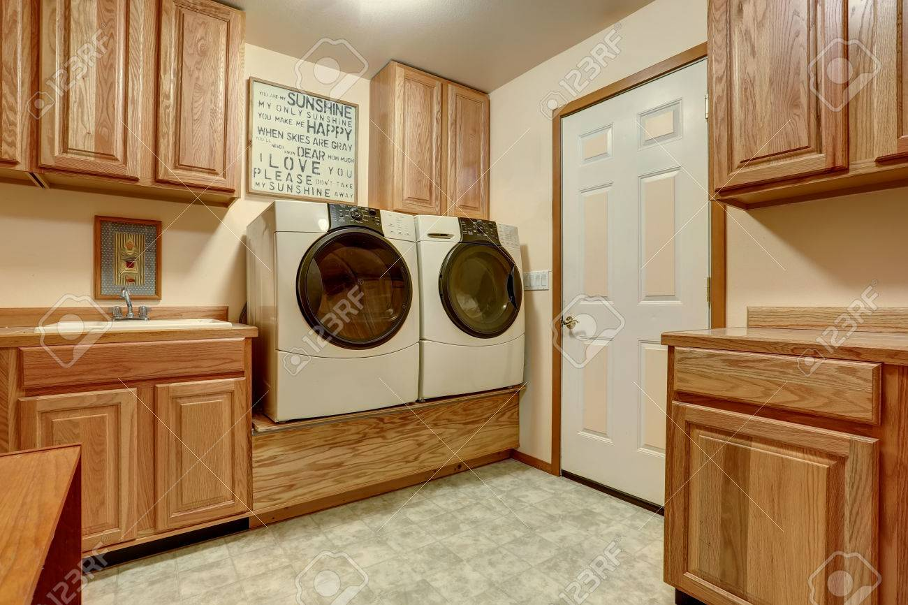 Laundry Room With Wooden Cabinets And Tile Floor. Northwest, USA Stock  Photo   61425782