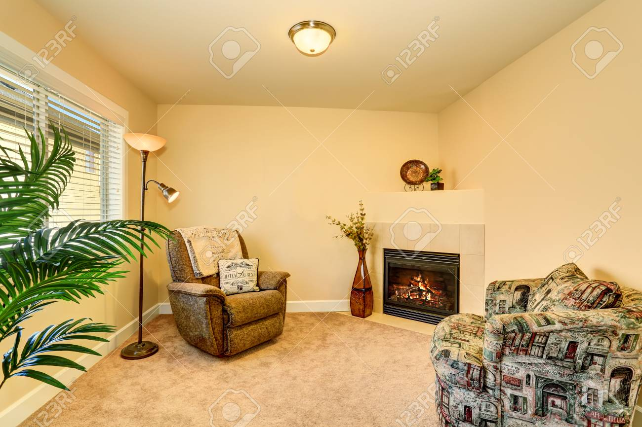 Cozy Family Room Interior In Warm Peach Colors With Two Armchairs ...