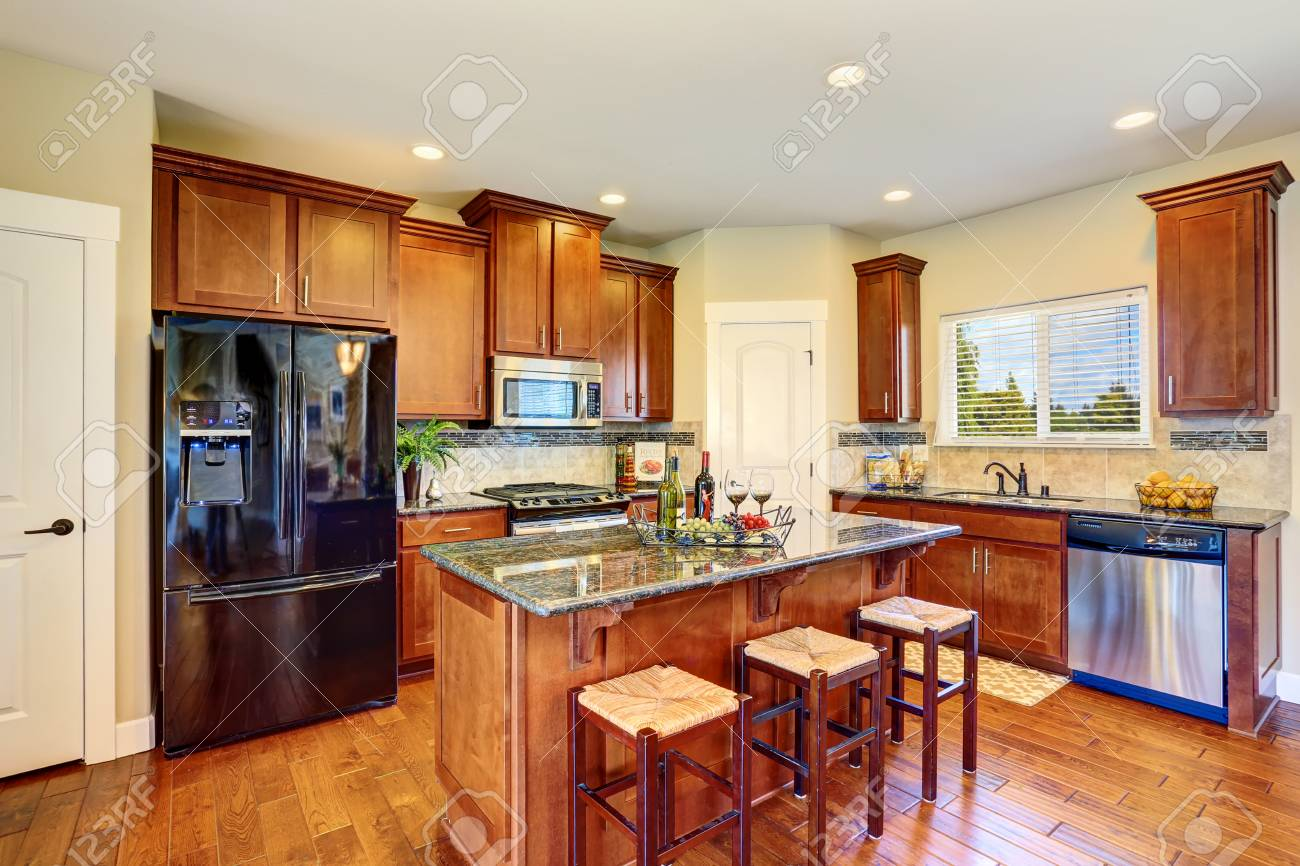 Luxury Kitchen Room With Modern Black Appliances Kitchen Island Stock Photo Picture And Royalty Free Image Image 61425543