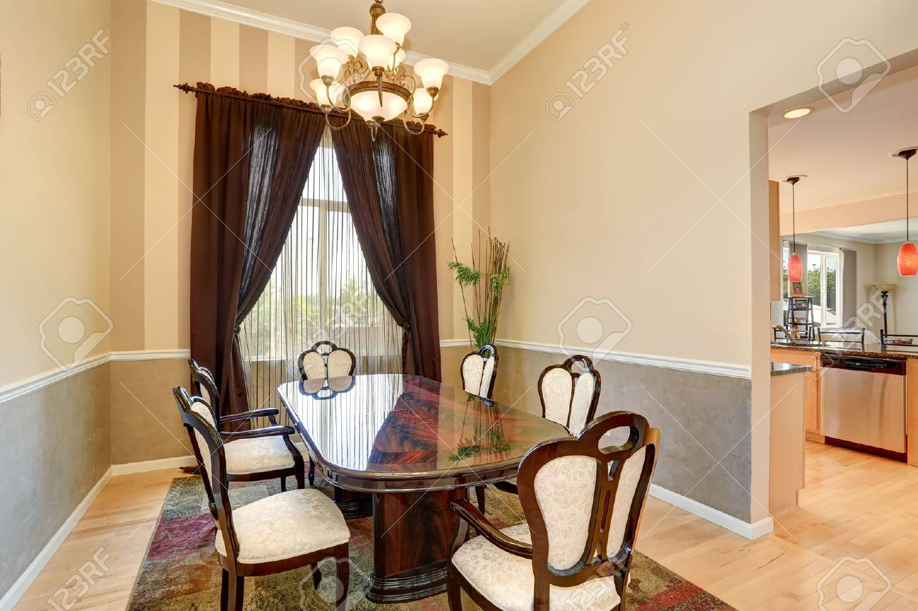Dining room interior with nice table set and brown curtains...