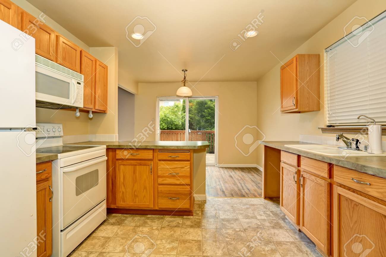 Classic American Kitchen Room Interior With Wooden Cabinets And Tile Floor.  Northwest, USA Stock