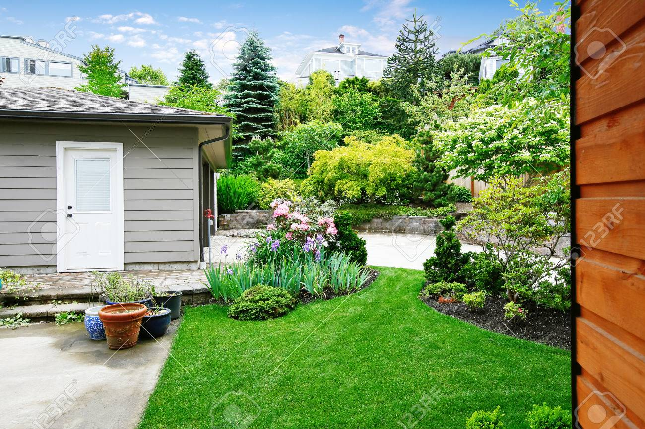 nice back yard landscape desing with well kept lawn separate