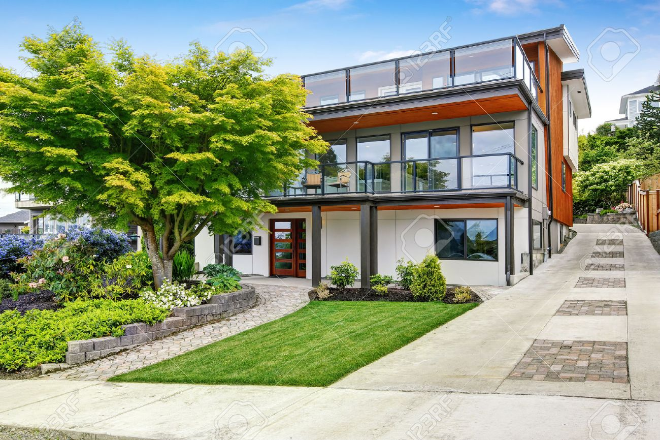 Modern Three Level House Exterior With Wooden Trim And Spacious ...