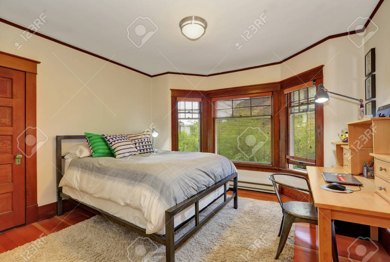 White and brown bedroom interior. Furnished with king size bed..