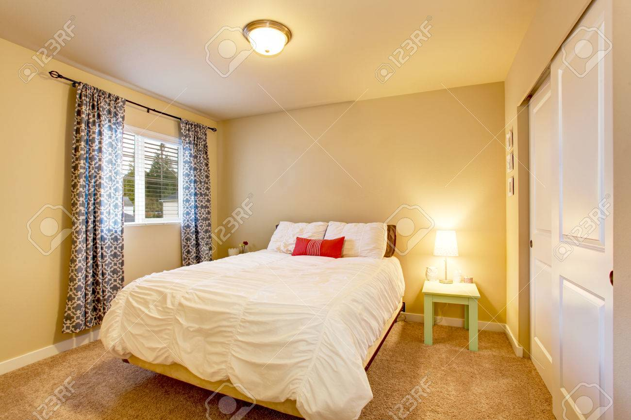 Lovely Bedroom Interior With Beige Walls And Nice Curtains. Also ...
