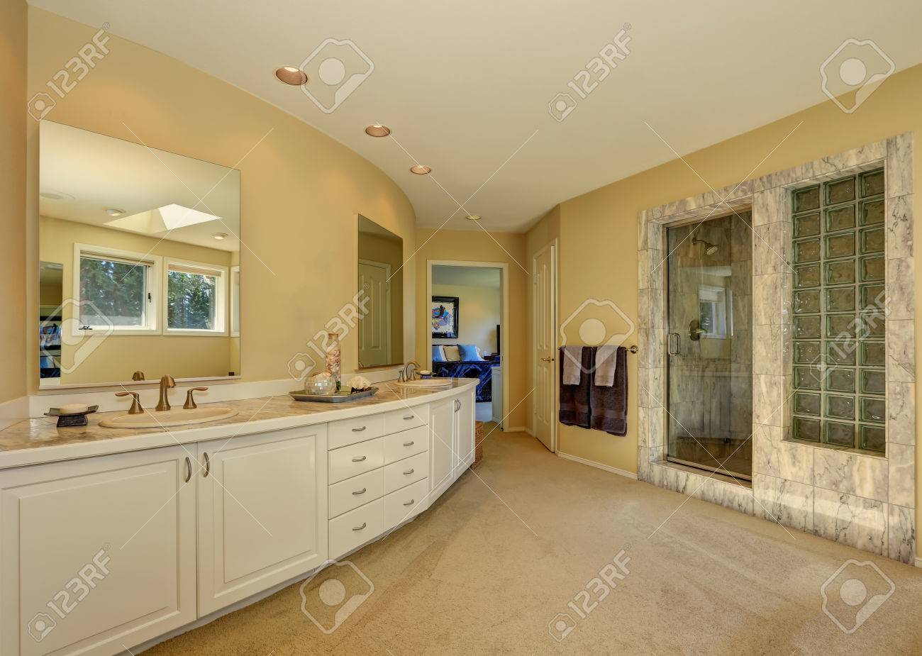 Master Marble Bathroom Interior With Long White Vanity And Beige Stock Photo Picture And Royalty Free Image Image 61648818