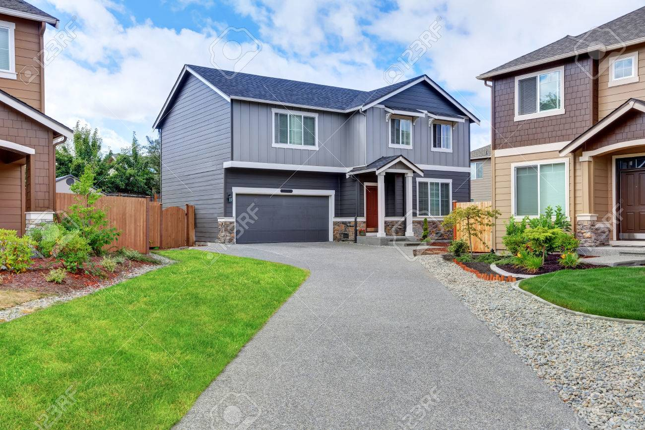 Gray House Exterior With Dark Blue Roof And Long Driveway Tacoma