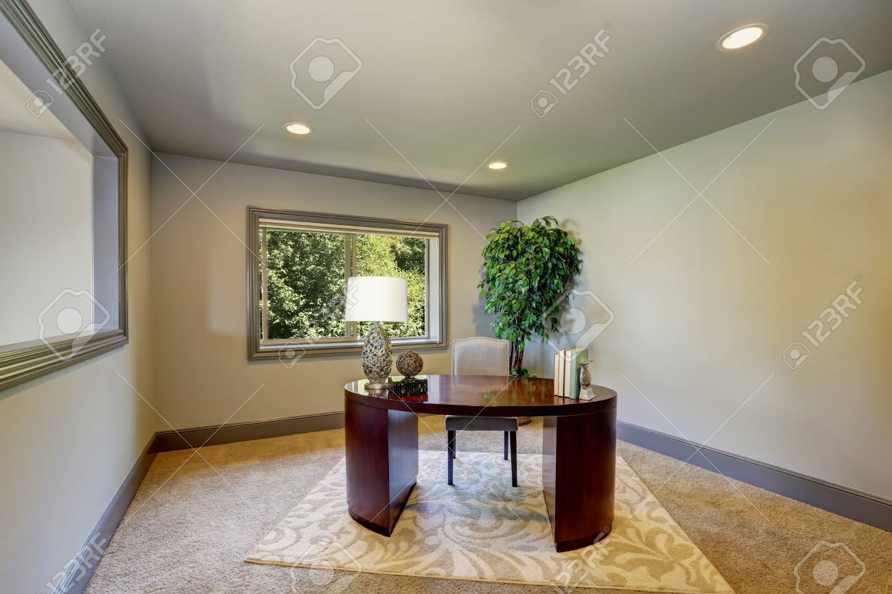 Simple Home Office Interior With Burgundy Wooden Desk And Decorative Tree  In A Pot. Northwest