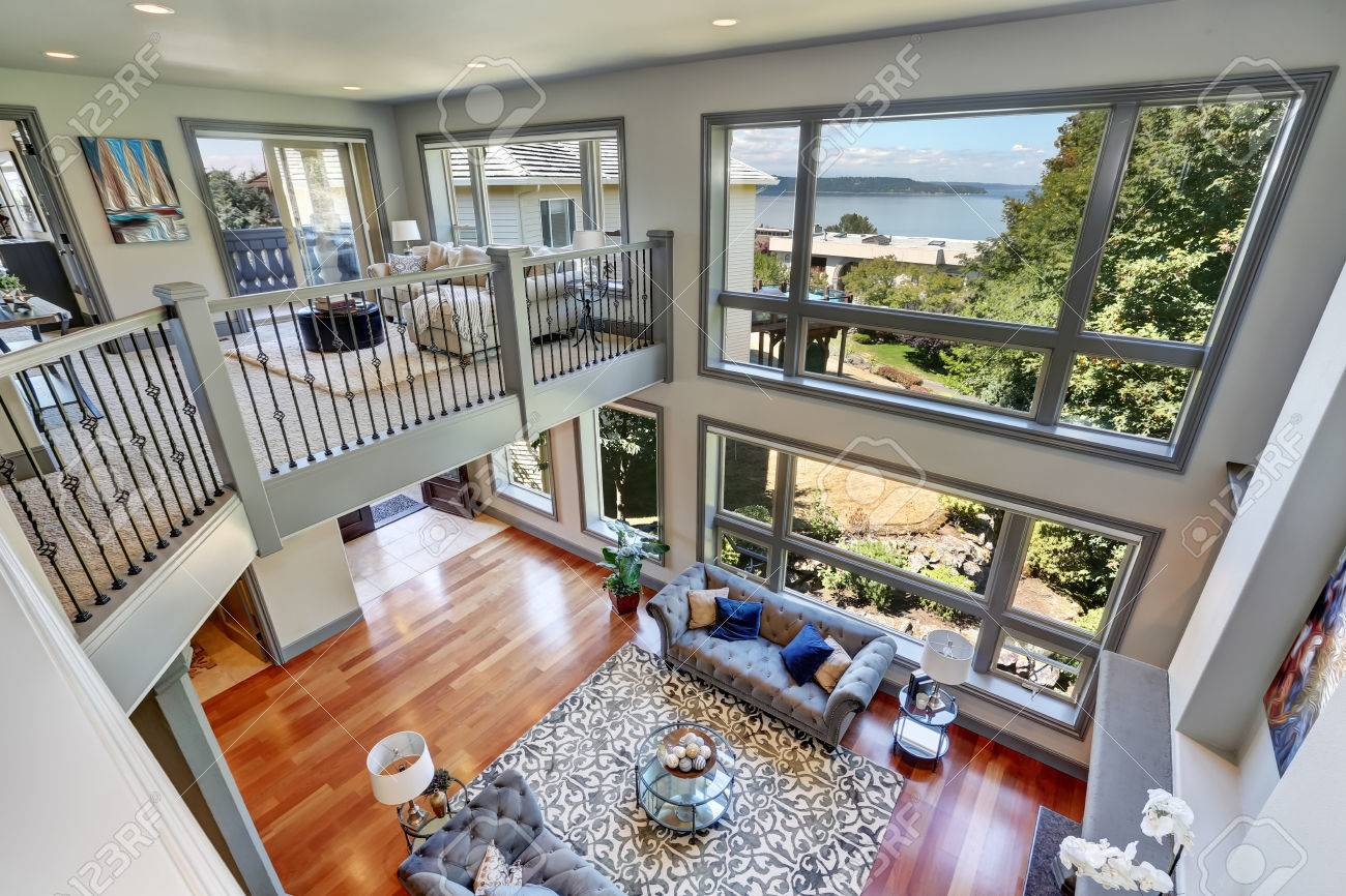 Panoramic View Of Elegant Grey Living Room From Upstairs High