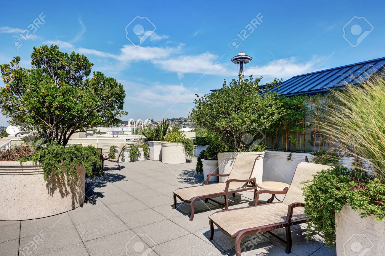 Apartment Building Roof Top Terrace Exterior With Lounge Chairs And Lots Of  Greenery. Northwest,