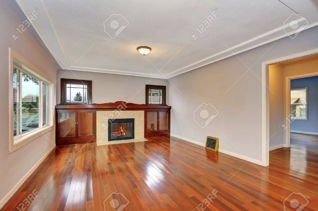 Empty Living Room Interior With Polished Hardwood Floor Fireplace