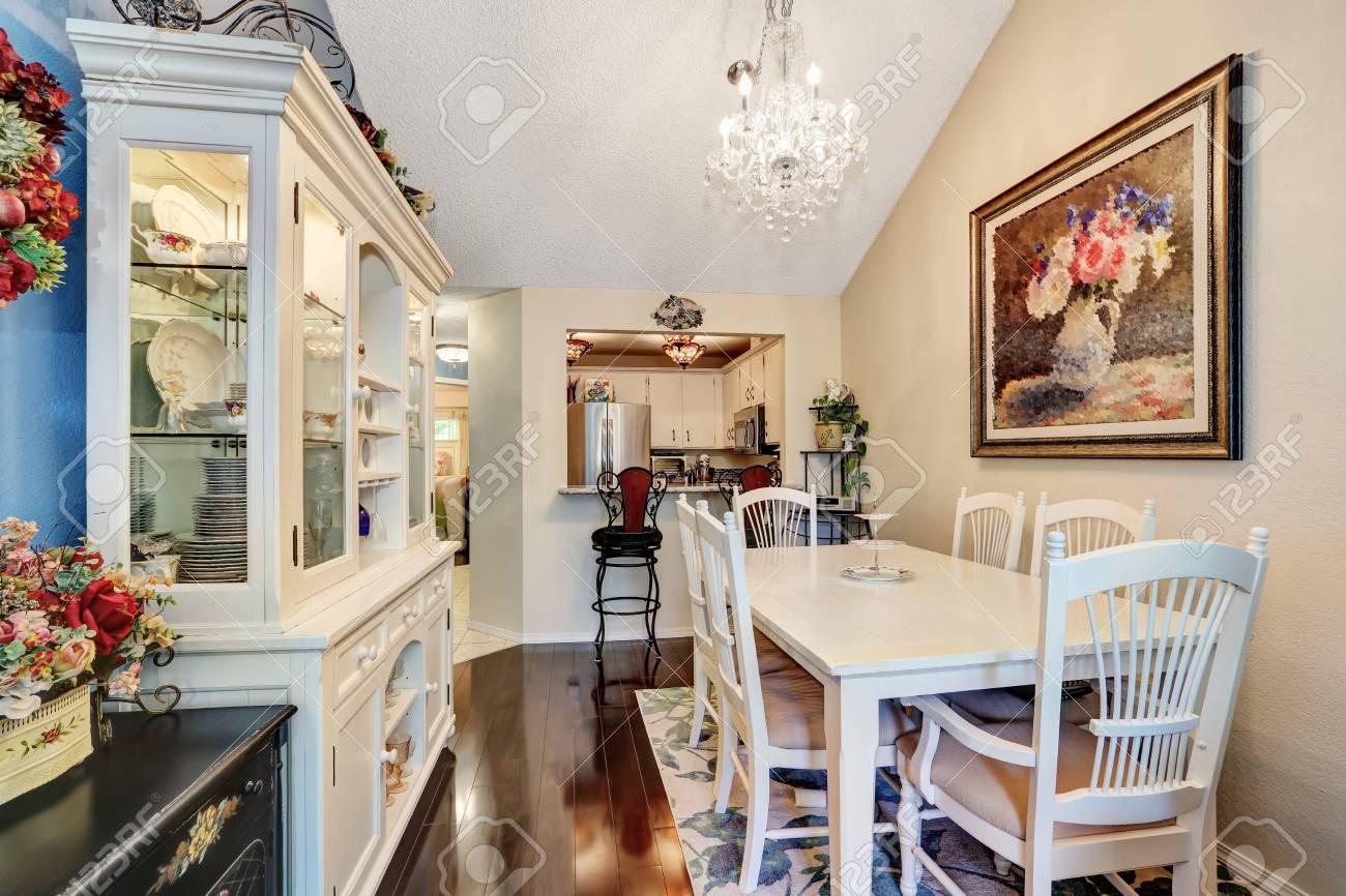 Superb White Wooden Dining Table Set, Elegant Chandelier And Vintage Cupboard.  Kitchen