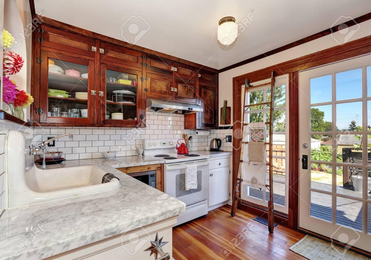 - Vintage Kitchen Cabinets And White Tile Back Splash Trim. Kitchen