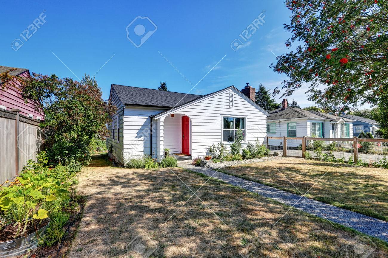 Small White Rambler House With Red Front Door View Of Neighborhood