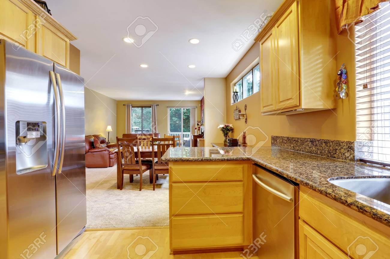 Light Tones Kitchen Interior With Modern Steel Double Doors Fridge Polished Granite Counter Tops