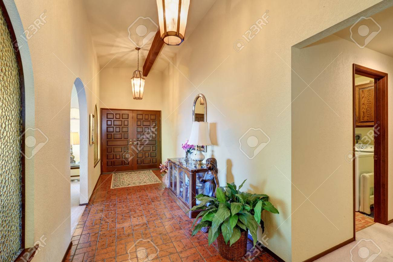 High Ceiling Hallway With Pendant Lights And Brown Tile Flooring Stock Photo Picture And Royalty Free Image Image 61776231