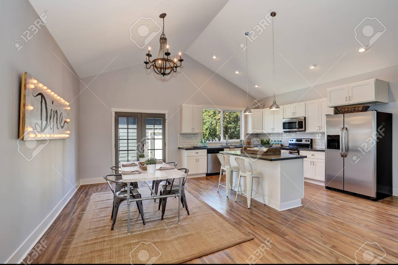 White Kitchen Vaulted Ceiling interior of kitchen and dining room with high vaulted ceiling