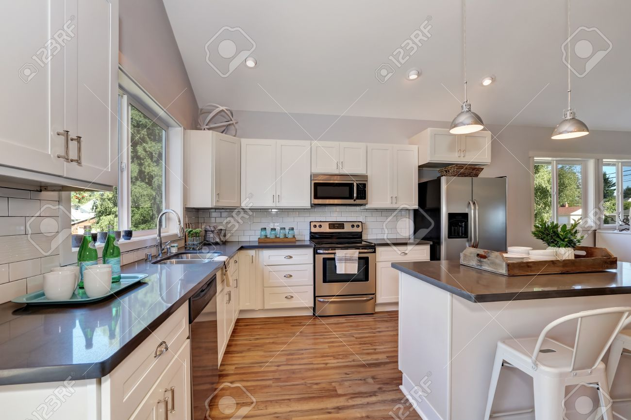Kitchen Cabinets Vaulted Ceiling interior of kitchen with high vaulted ceiling, pendant lights