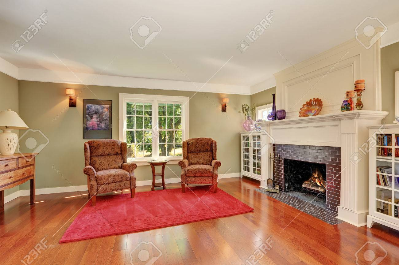 Nice Living room with vintage furniture and red rug. Also brick..