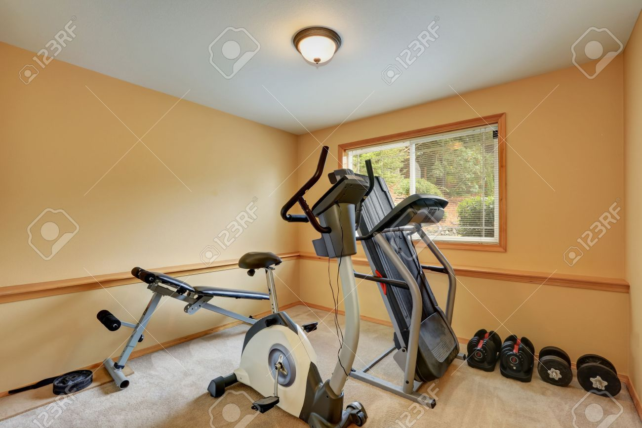 Small gym room with exercise equipments house interior northwest