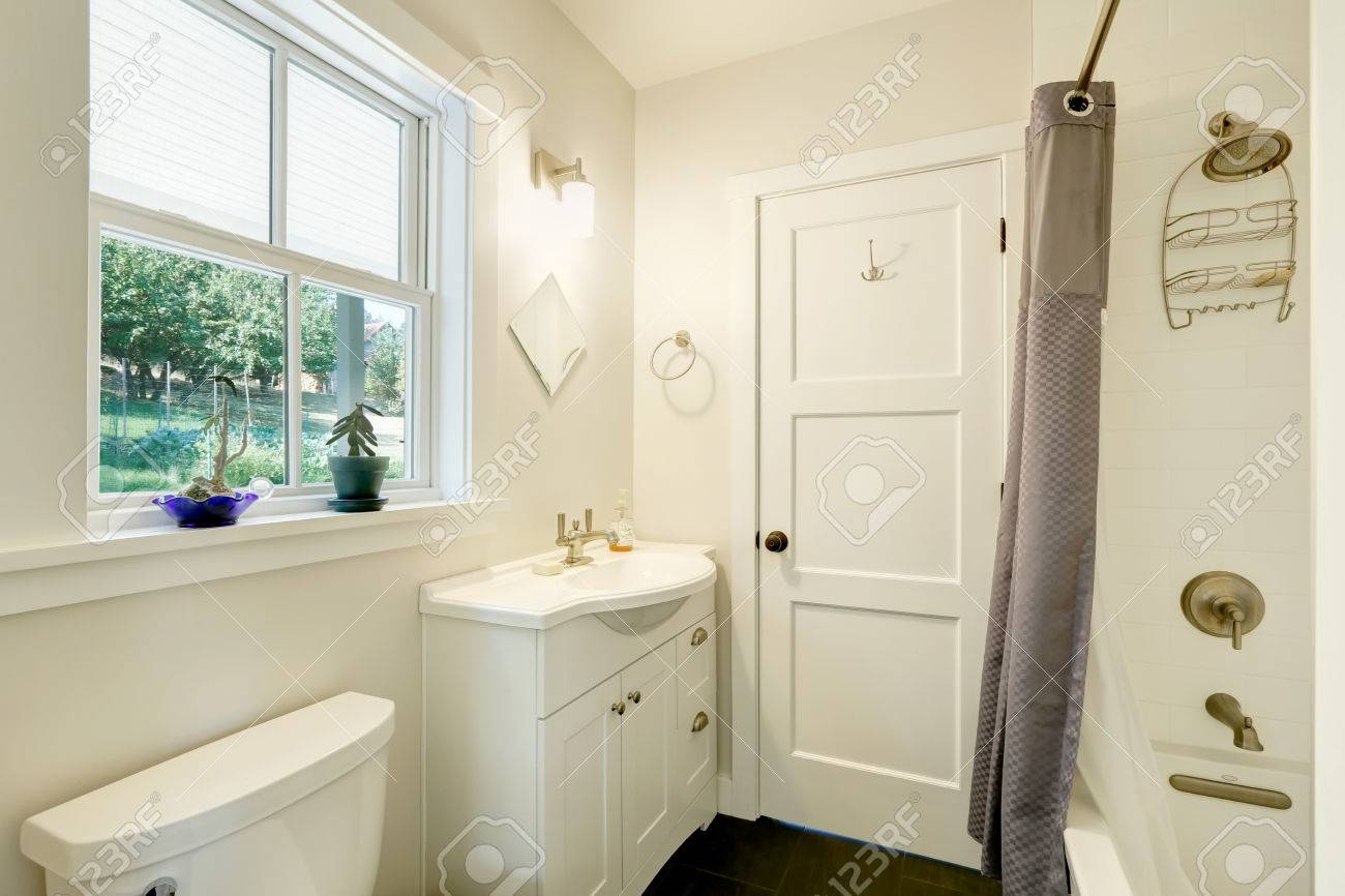 White Clean Bathroom Interior. Small Vanity Cabinet With A Sink ...