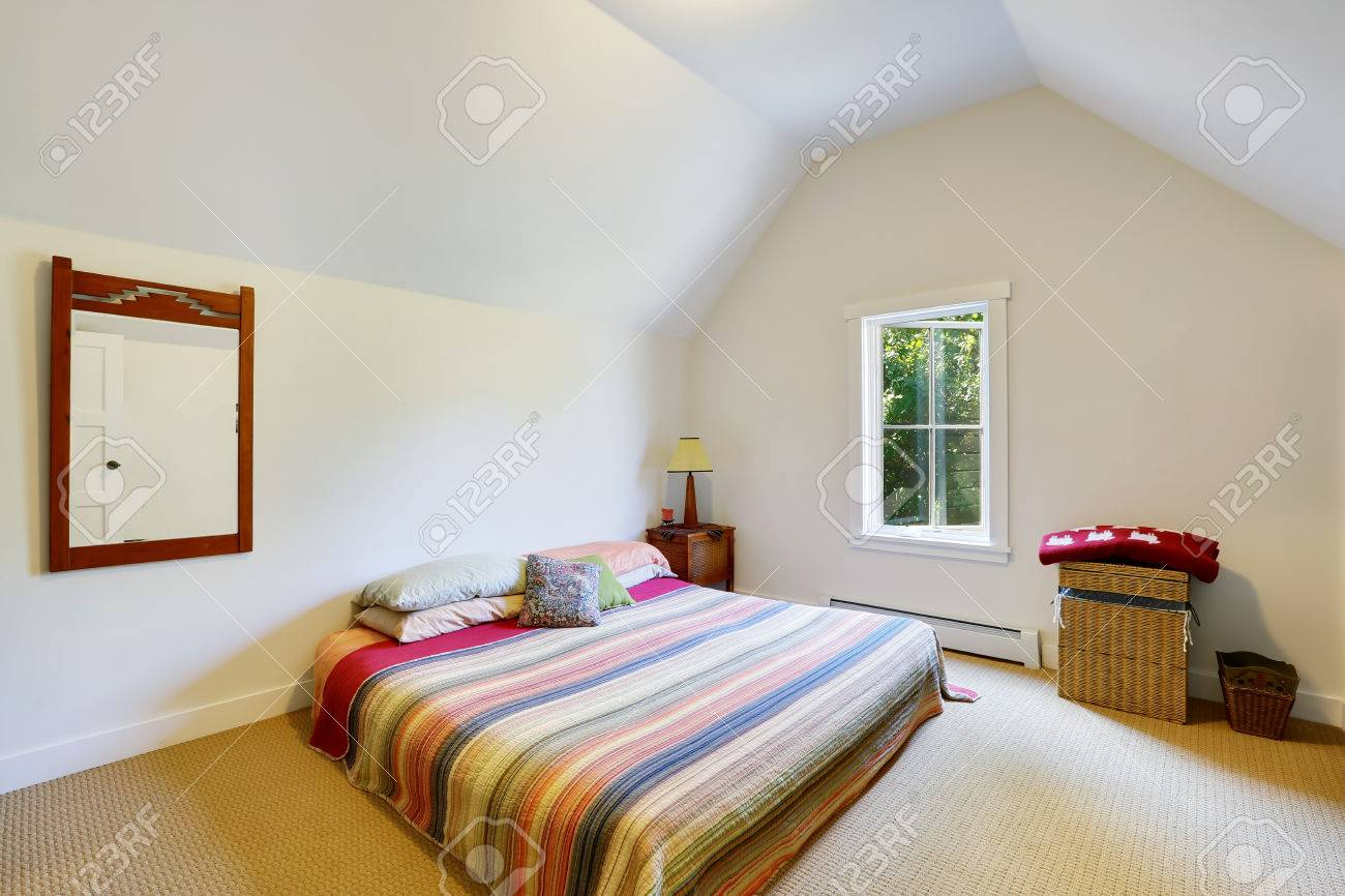 . Simple design of attic bedroom with vaulted ceiling  Wicker box