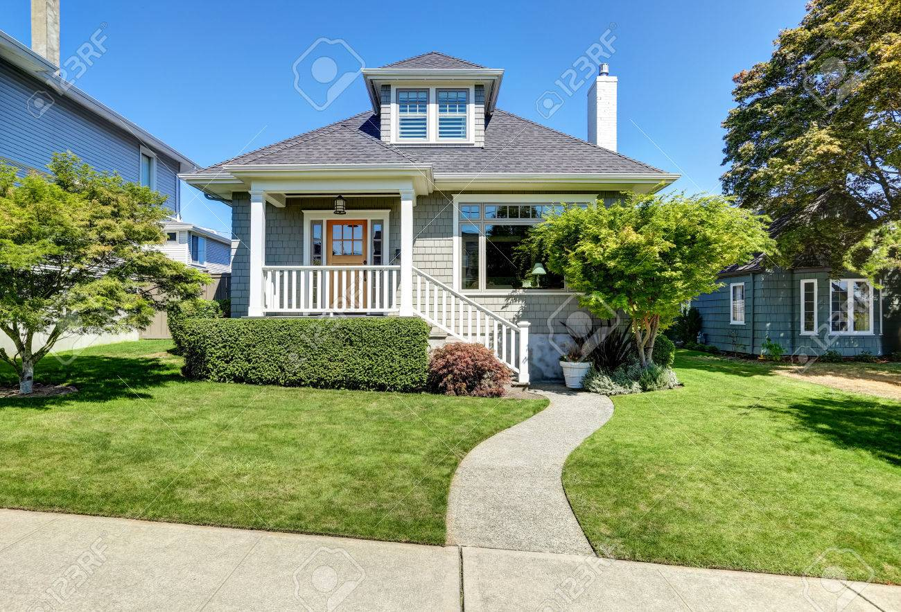 Simple American Craftsman Style Home - 61882567-single-family-american-craftsman-house-exterior-blue-sky-background-and-nicely-trimmed-front-yard-no  Snapshot_202648.jpg