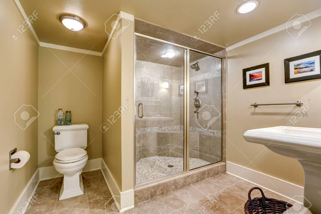 Elegant Beige Bathroom Interior With Modern Glass Walk-in Shower ...