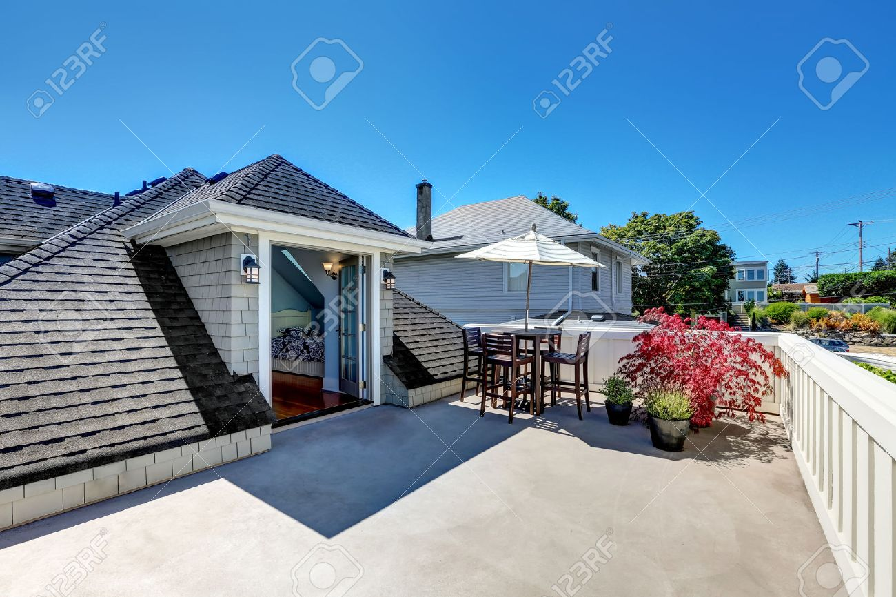 craftsman house roof top terrace with living area with plant craftsman house roof top terrace with living area with plant pots table set with umbrella