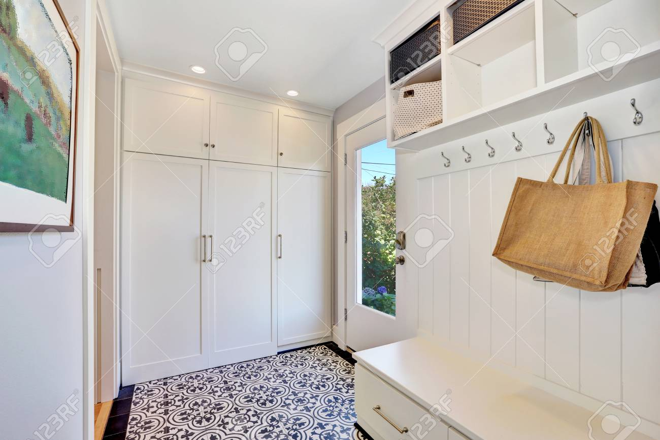 Stock Photo   White Hallway Storage Cabinet With Hangers And Closet. Also  White And Black Floral Patterned Tile Floor In Vintage Style. Northwest, USA