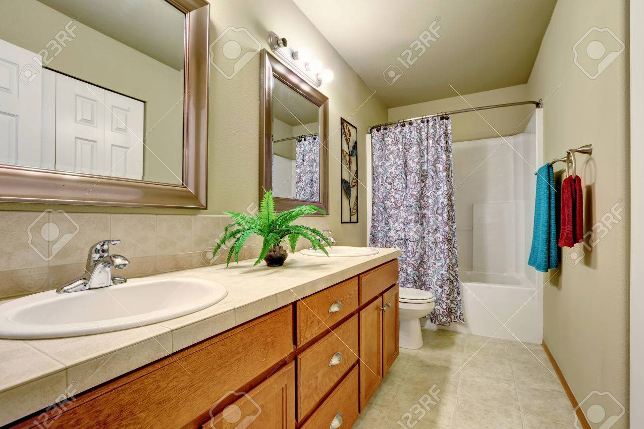 Long Double Sink Bathroom Vanity With Drawers And Two Mirrors Stock Photo Picture And Royalty Free Image Image 62184688
