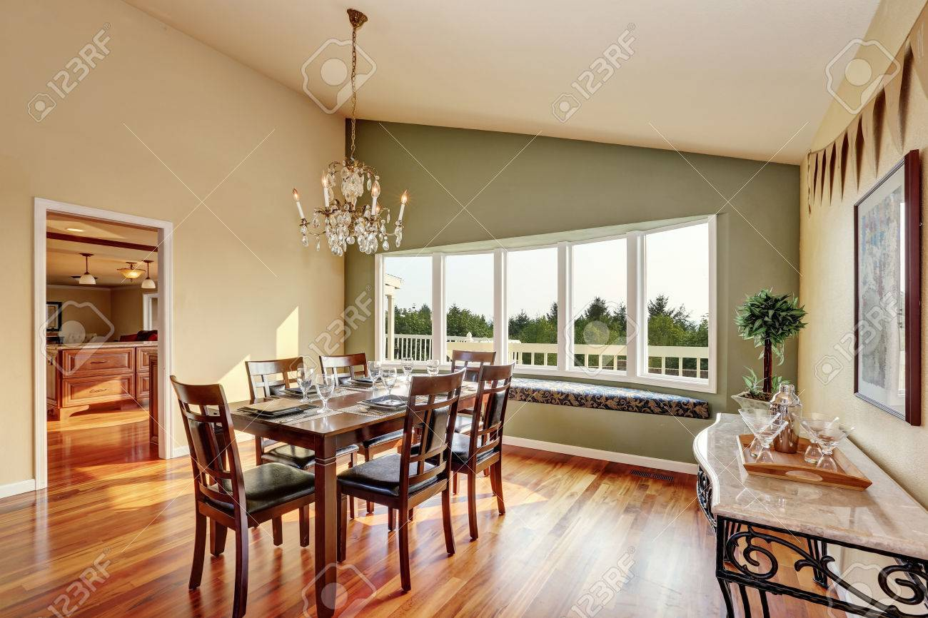 Elegant Dining Room With Contrast Olive Wall, Vaulted Ceiling ...