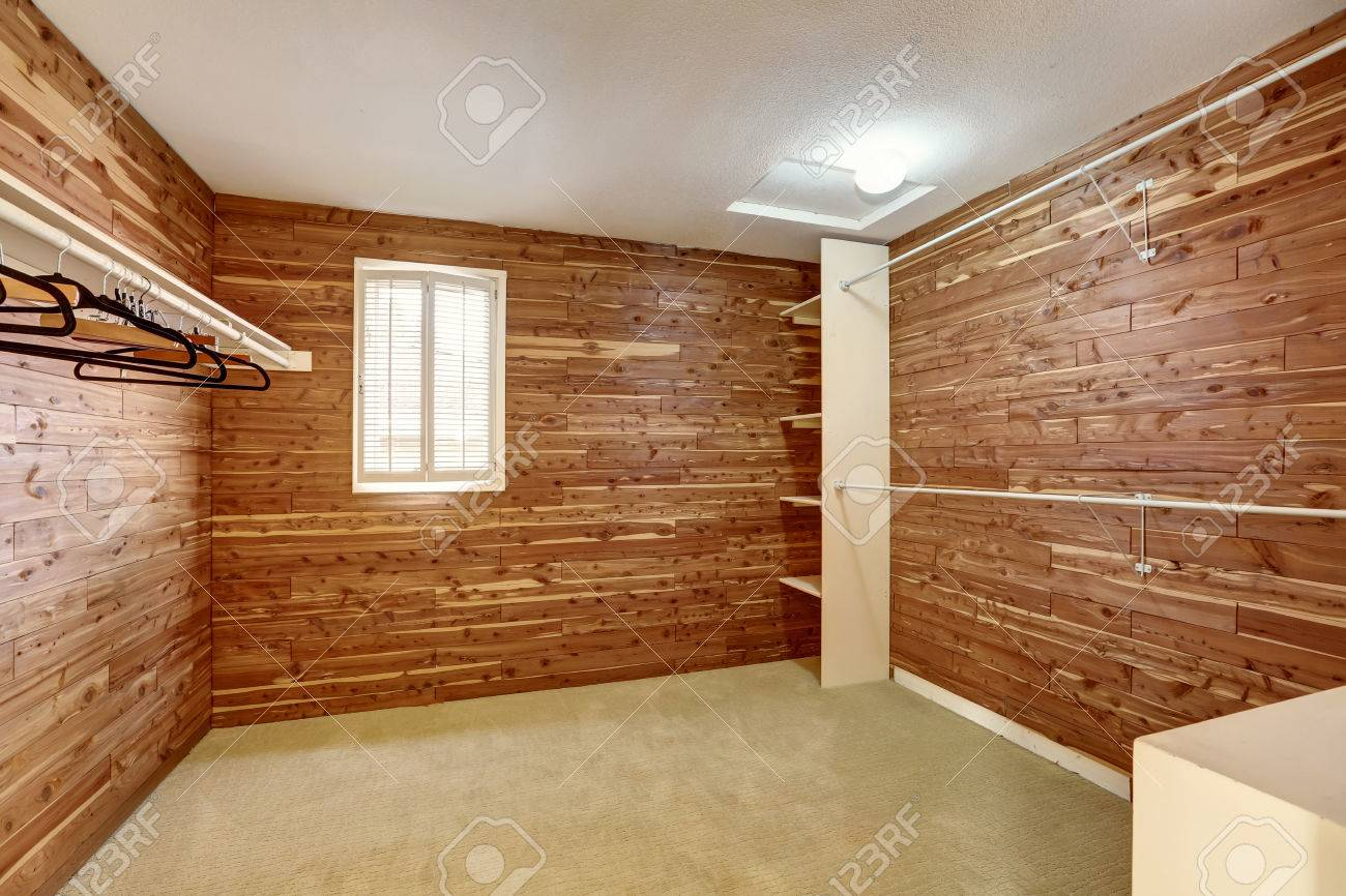 Empty Walk In Closet With Wooden Walls And Carpet Floor. Northwest, USA  Stock