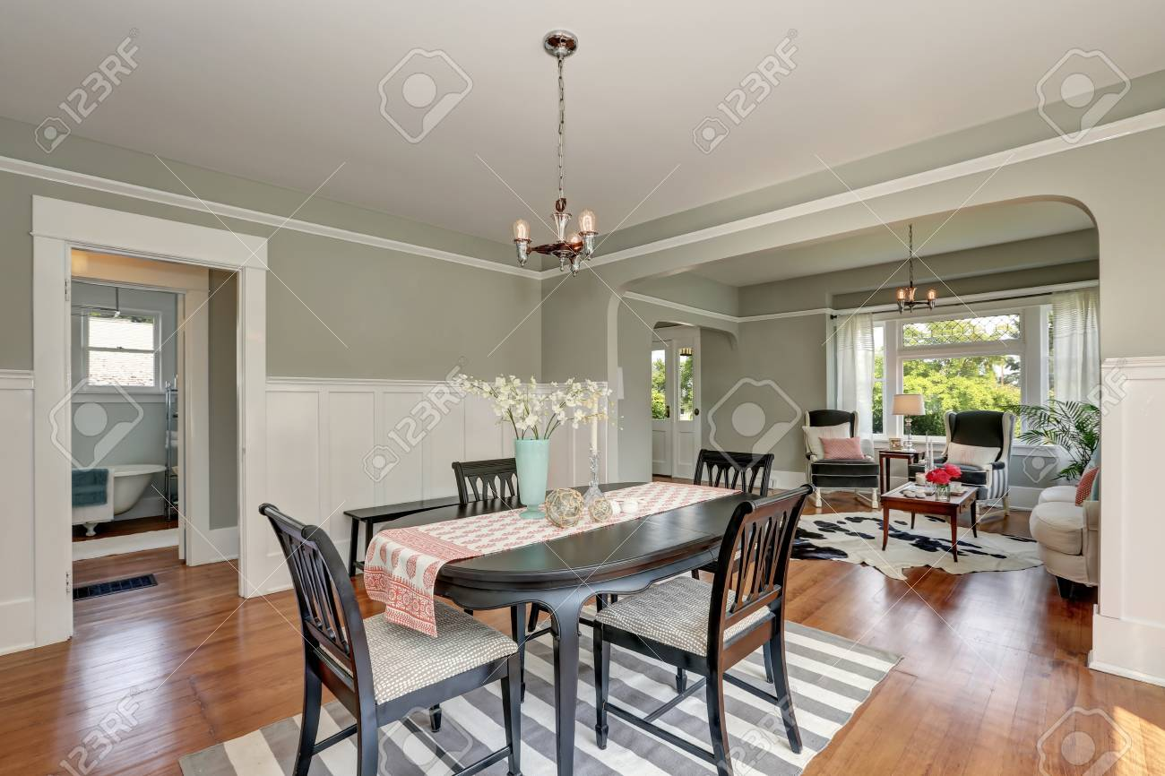 View of a classic dining room with gray walls and medium tone..