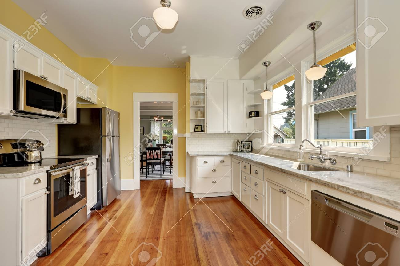 Kitchen Interior With White Cabinets Stainless Steel Appliances