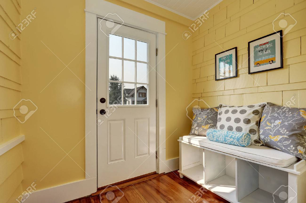 Superb Entryway With Yellow Walls And Storage Bench In White With Colorful Gmtry Best Dining Table And Chair Ideas Images Gmtryco
