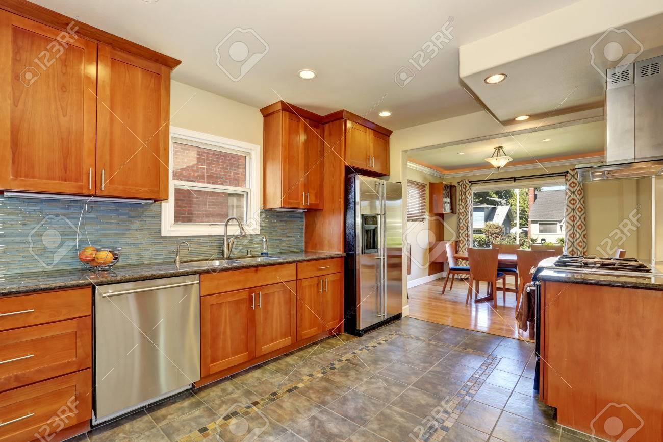 Kitchen Interior With Tile Flooring And Modern Brown Cabinets Stock Photo Picture And Royalty Free Image Image 62161215