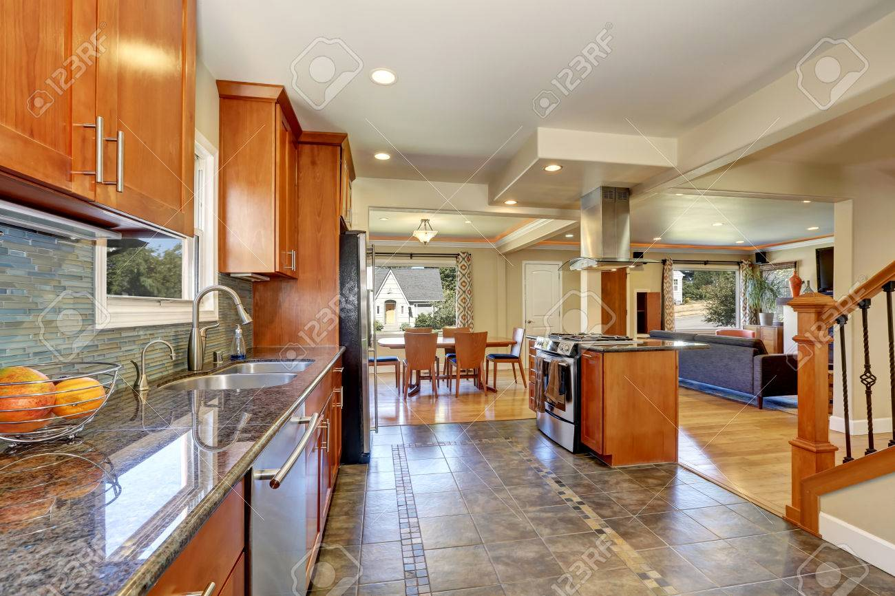 Image of: Kitchen Interior With Tile Flooring And Modern Brown Cabinets Stock Photo Picture And Royalty Free Image Image 62161258