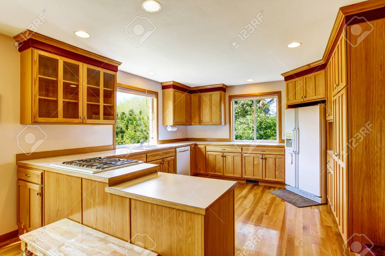 Light Brown Kitchen Cabinets White Appliances And Hardwood Floor Stock Photo Picture And Royalty Free Image Image 63740514
