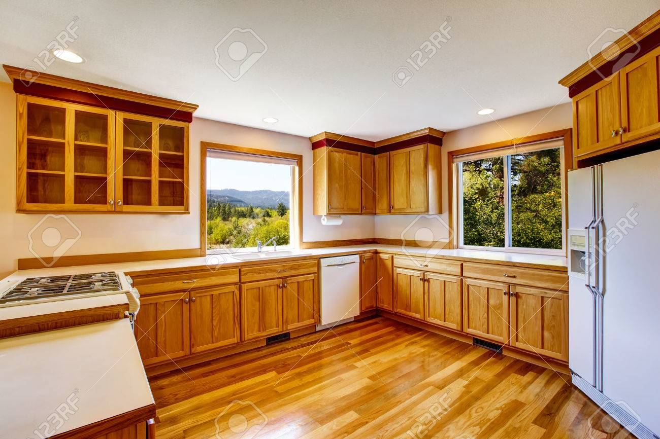 Light Brown Kitchen Cabinets White Appliances And Hardwood Floor Stock Photo Picture And Royalty Free Image Image 63740324