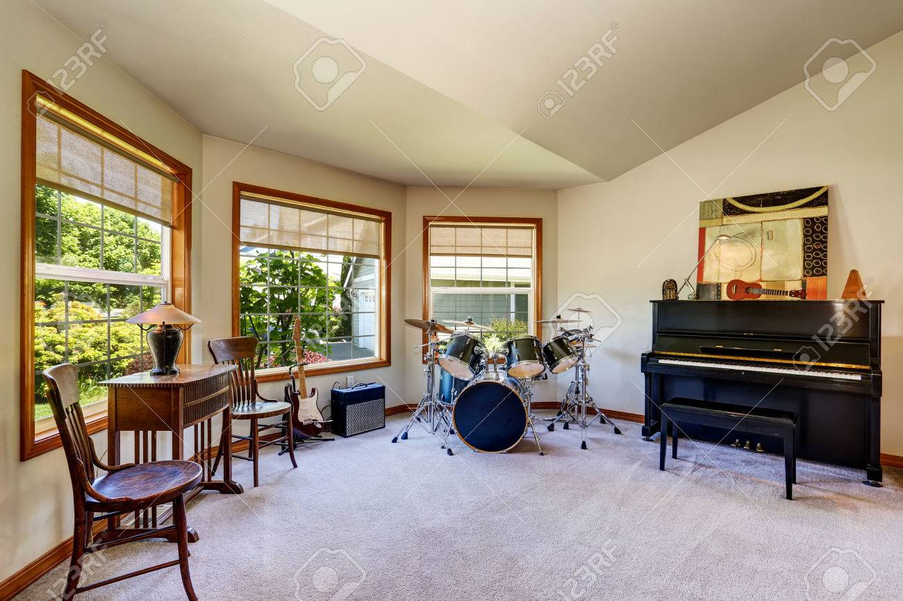 musician s room interior with drum set guitars and piano small rh 123rf com electronic drum set music room soundproof drum set room