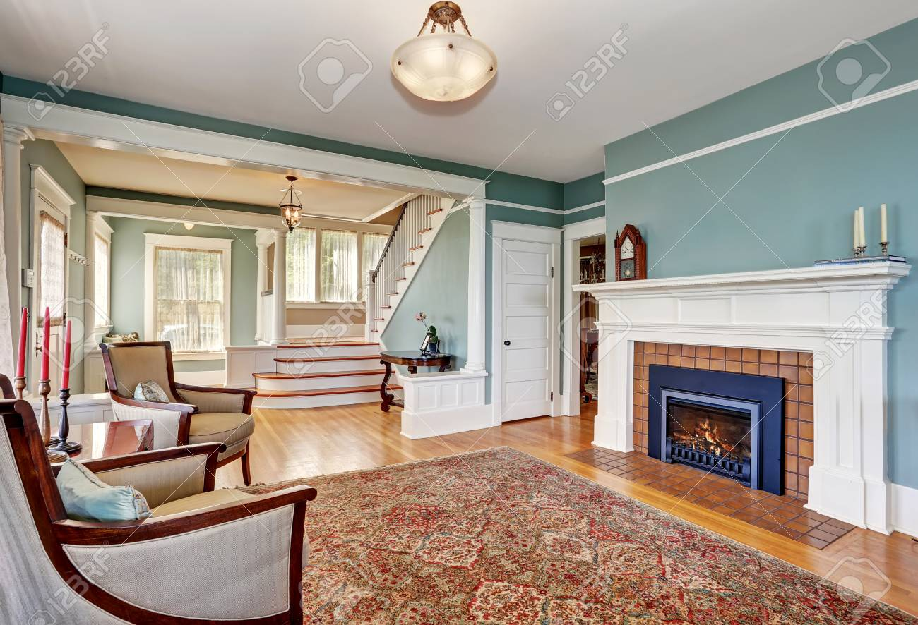 Traditional Living Room Interior In Blue And White Tones Fireplace