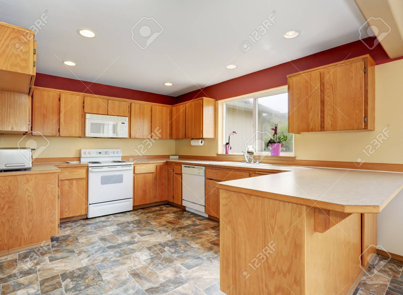 Classic Kitchen Room Interior With Tile Floor And Wooden Cabinets. Northwest,  USA Stock Photo