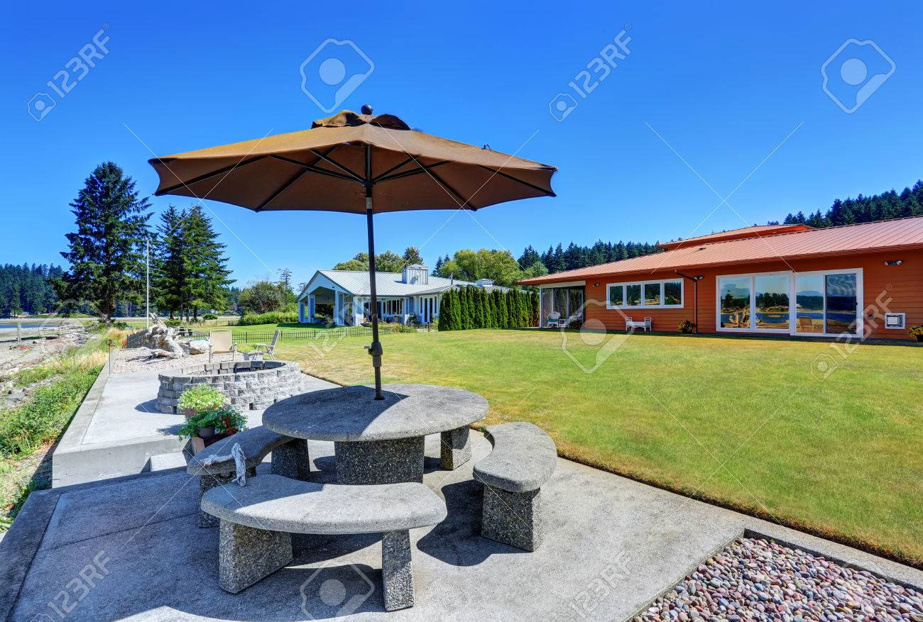 Back Yard With Stone Patio Table Set And Fire Pit. One Story.. Stock ...