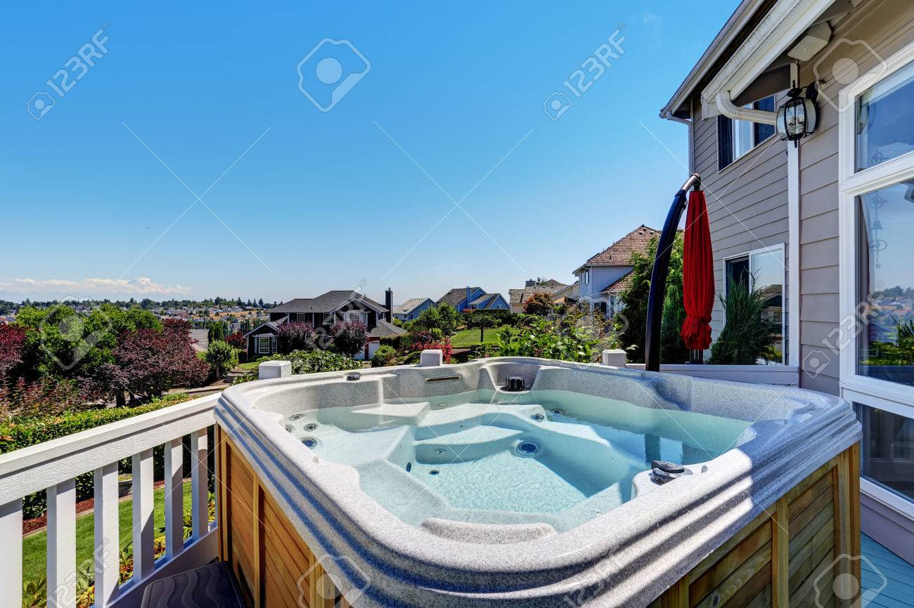 Close-up Of Wooden Hot Tub. Luxury House Exterior. Blue Sky ...