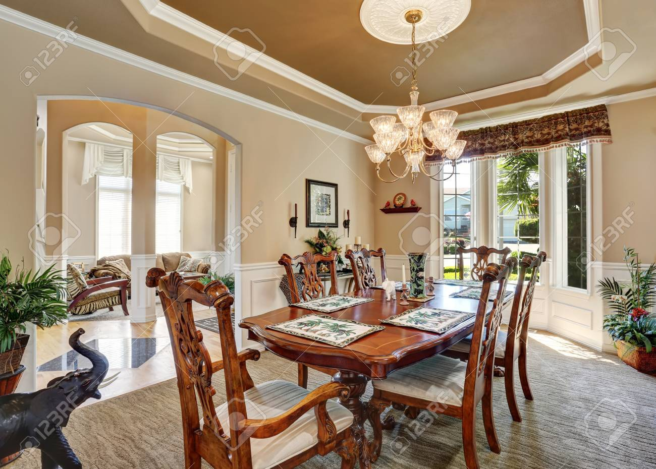 Gorgeous Dining Room Interior Design With Vintage Furniture, French  Windows. Elegant Chandelier Above Carved
