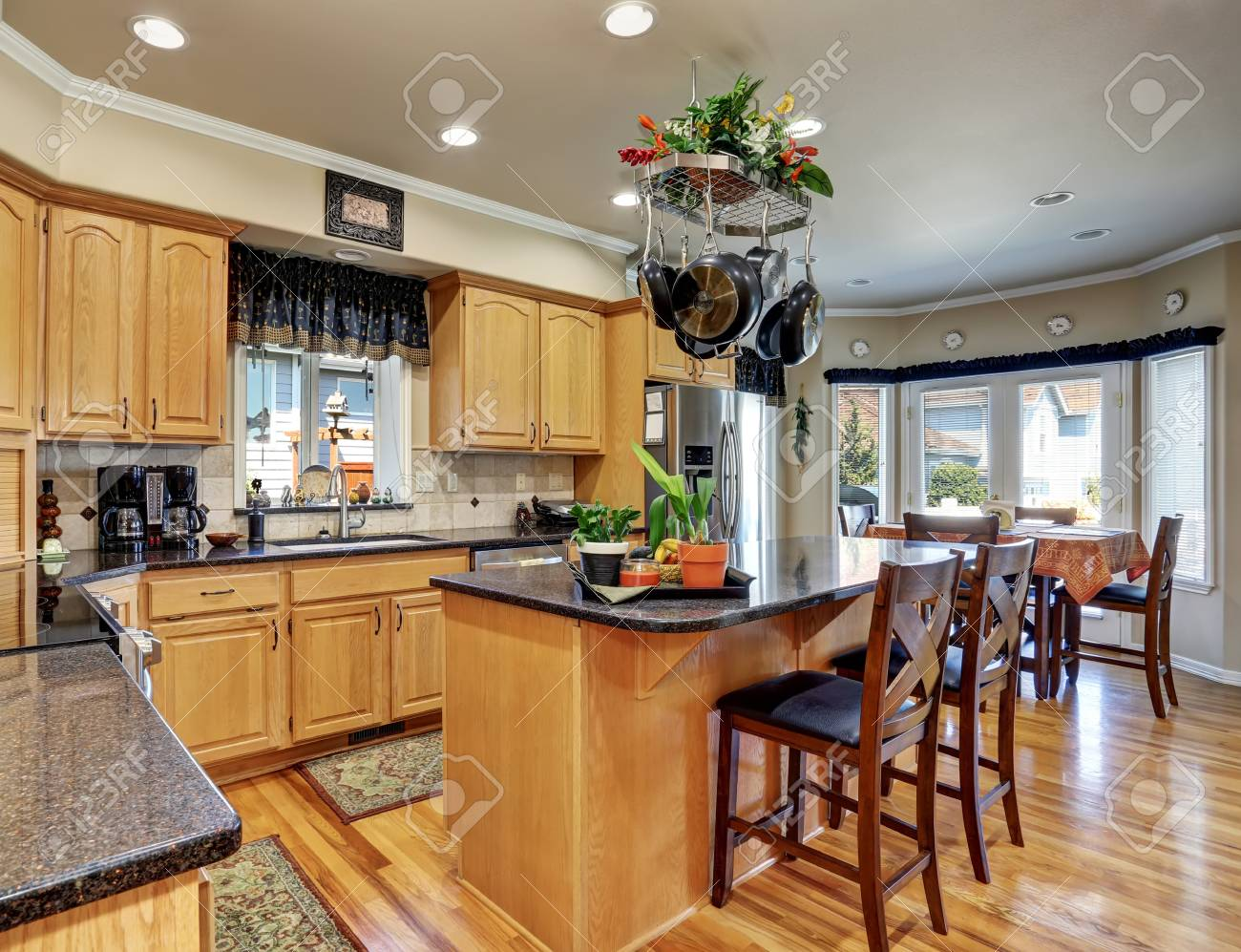 Kitchen and dining room interior in Luxury house. Maple cabinets..